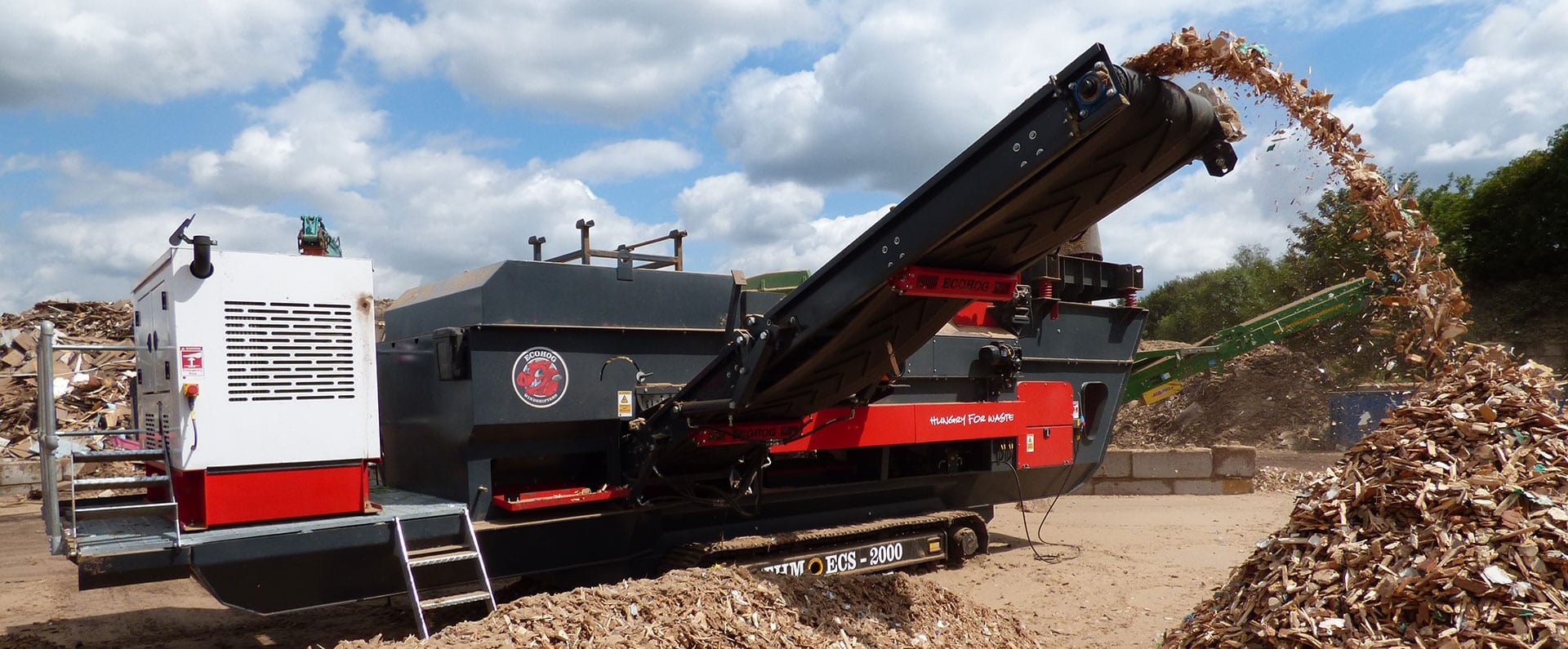 Ecohog Tracked HogMag machine processing wood