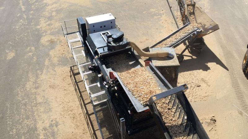 Tracked Eddy Current Separator cleaning woodchip to remove metals and light materials such as plastic and paper