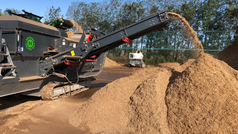 Tracked Eddy Current Separator removing metal from wood waste to be reused